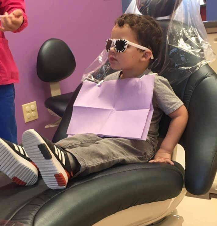 Little boy in dentist chair - Dental Services