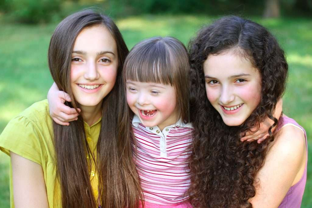 Girl with special needs and friends
